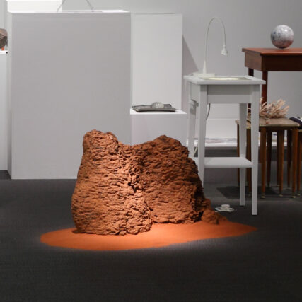 detail of termite mound and sand in the Lawrence Wilson Art Gallery