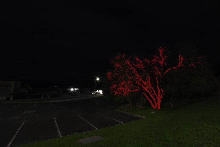 a carpark in the dark with a strange blue light