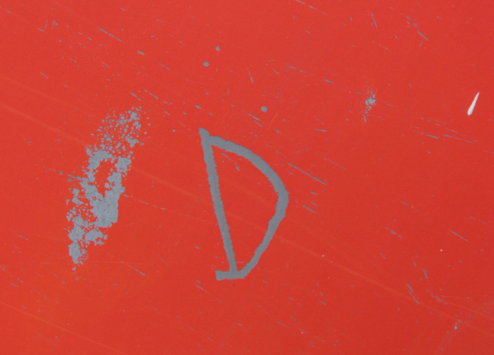 scratched in red paint